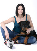Woman with a Rottweiler dog — 图库照片