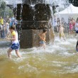 Kids swimming in a fountain — Stock Photo