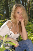 Beautiful woman in summer forest — Stock Photo