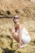 Blondy girl with sunglasses on the beach. Tenerife — Stock Photo