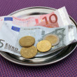 Euro tips on restaurant table — Stockfoto #12505233