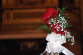 Bouquet of flowers in church — Stock Photo