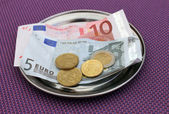Euro tips on restaurant table — Stok fotoğraf