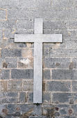 Religious cross on old wall — Stock Photo