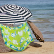 Parasols on sandy beach — Stock Photo