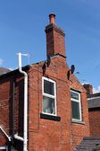 Old red brick house with chimney — Stock Photo