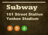 Grunge Yankee Stadium subway sign — Stock Photo