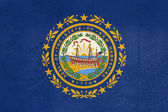 Grunge New Hampshire state flag — Stock Photo