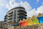 Hotel building and chalets — Stock Photo
