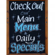 Main menu and daily specials sign — Stock Photo