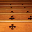 Row of wooden pews in church — Stock Photo #20340935