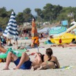 Sunbathers on Spanish beach - Stock Photo