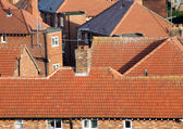 Red tiles on house roofs — Stock Photo