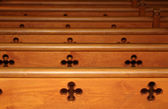 Row of wooden pews in church — Stock Photo