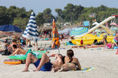 Sunbathers on Spanish beach — Stok fotoğraf