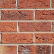 Red brick wall background — Stockfoto