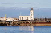 Scarborough harbor lighthouse — Stock Photo