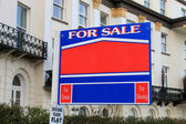 For sale sign outside old house — Stock Photo