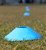 Sports training cones on soccer pitch — Stock Photo