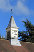 Clock tower and weather vane — Stock Photo