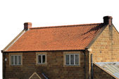 Brick house with red roof tiles — Stock fotografie
