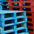 Colorful stacks of crate pallets — Foto Stock