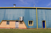 Blue and yellow warehouse — Stock Photo