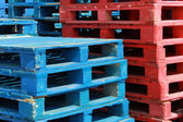 Colorful stacks of crate pallets — Stock Photo