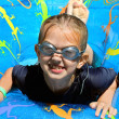 Girl playing in swimming pool — Stock Photo