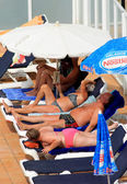 Middle aged people sunbathing — Stok fotoğraf