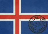 Welcome to Iceland flag with passport stamp — Stock Photo