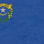 Nevada state flag on brick wall — Stock Photo