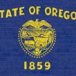 Oregon state flag on brick wall — Stock Photo