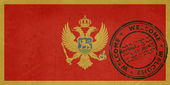 Welcome to Montenegro flag with passport stamp — Stock Photo