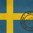 Welcome to Sweden flag with passport stamp — Stock Photo