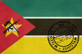 Welcome to Mozambique flag with passport stamp — Stock Photo
