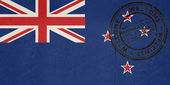 Welcome to New Zealand flag with passport stamp — Stock Photo