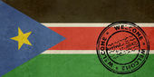 Welcome to South Sudan flag with passport stamp — Stock Photo