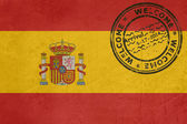 Welcome to Spain flag with passport stamp — Stock Photo