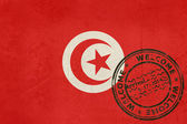 Welcome to Tunisia flag with passport stamp — Stock Photo