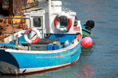 Fishing boat moored in a harbor — Stock Photo