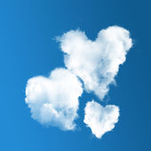 Three heart-shaped clouds on blue sky — Stock Photo
