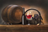 Still life with red wine and old barrel — Stock Photo