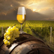 Photo: Still life with white wine and old barrel