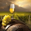 Foto Stock: Still life with white wine and old barrel