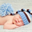 A newborn baby is wearing a blue hat — Stock Photo #11301836
