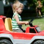 Boy in Toy Car — Stock Photo