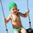 Boy swinging with a big smile — Stock Photo