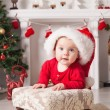 Happy small girl in santa hat - Stock Photo