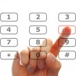 Finger push a telephone number button — Stock Photo